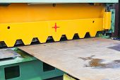 picture of guillotine  - blade of cutting machine for metal sheets in mechanical workshop - JPG