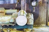 stock photo of locksmith  - metal part and drill of boring lathe machine close up in locksmith shop - JPG