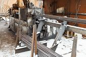 stock photo of bender  - rebar and reinforcing steel cutting and bender machine in outdoor workshop - JPG