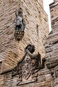 stock photo of braveheart  - Detail of William Wallace statue and coat of arms at The National Wallace Monument in Stirling Scotland - JPG