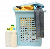 stock photo of detergent  - Plastic washing basket with detergent on white - JPG