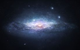 stock photo of enormous  - A picture of enormous galaxy with bright spiral core surrounded by countless stars - JPG