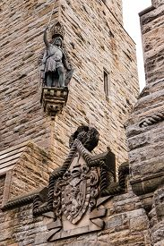 pic of scottish thistle  - Detail of William Wallace statue and coat of arms at The National Wallace Monument in Stirling Scotland - JPG