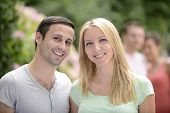 foto of heterosexual couple  - Portrait of a happy young heterosexual couple looking at camera - JPG
