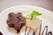 image of ice-cake  - chocolate cake with ice cream at white plate - JPG