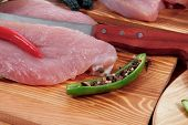 pic of kale  - fresh raw turkey meat steak fillet with vegetables kale tomatoes lettuce red hot chili pepper and dark olives on cutting board over wooden table - JPG
