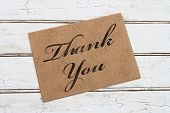 pic of thankful  - A thank you card A brown card with words Thank You over a distressed wood background - JPG
