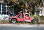picture of wreckers  - Abandoned red tow truck in the united states - JPG