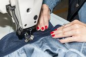 stock photo of sewing  - Industrial sewing machines sewing machine operator with chain - JPG