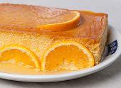 foto of custard  - Orange custard in a studio shot - JPG