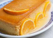 picture of custard  - Orange custard in a studio shot - JPG