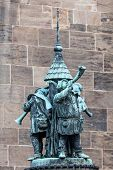 stock photo of trumpets  - Trumpet musicians statue in the old town of Bremen Germany - JPG
