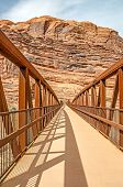 stock photo of pedestrians  - Pedestrian and bike bridge at the beginning of the Moab Canyon Pathway for pedestrians and bicyclists - JPG
