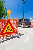picture of safety barrier  - Construction site is protected by several traffic signs and orange fence with flashing beacon lights for safety - JPG