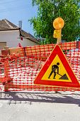 stock photo of safety barrier  - Construction site is protected by several traffic signs and orange fence with flashing beacon lights for safety - JPG