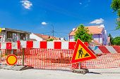 foto of safety barrier  - Construction site is protected by several signs and orange fence for safety - JPG