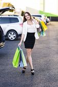 foto of shopping center  - Woman after shopping in a mall or shopping centre and driving home now with her car - JPG