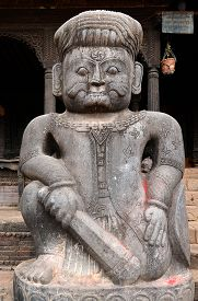 picture of lingam  - Stone statue of a fighter guardian at Nyatapola Hindu temple in Bhaktapur Nepal - JPG