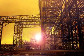 picture of tubes  - metal structure of industry chemical tube in heavy industrial estate against beautiful sun rising with lens flare effect use for industry background - JPG