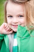 Smiling Little Girl In Green Jacket