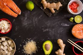 picture of soy sauce  - Overhead shot of ingredients for sushi on dark background - JPG