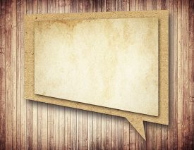 picture of bubble sheet  - Paper speech bubble with shadow on brown wooden wall - JPG