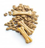 Dog chew bone and dry kibble dog food isolated on white background. poster