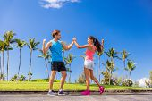 Challenge success runners people high fiving for fitness goal achievement. Athletes couple cheering  poster