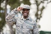Portrait of happy military soldier in boot camp poster