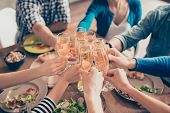 Cropped Close Up Photo Of Glasses With Champagne. Young People Are Toasting To Celebrate The Event. poster