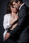 Young Passionate Couple Embracing And Able To Kiss In Erotic Scene poster