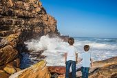The concept of active tourism and recreation. Travel to South Africa. Two boys standing  on Cape of  poster