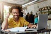 Happy Positive African American College Student With Cheerful Cute Smile Using Wireless Internet Con poster