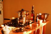 foto of kitchen utensils  - kitchen utensils stand on a table on the background of brow wall - JPG