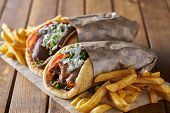 tasty greek gyros with fries with feta cheese and tzattziki sauce poster