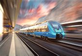 Постер, плакат: High Speed Train In Motion At The Railway Station