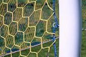 Hang Bended Blue Yellow Soccer Nets, Soccer Football Net. Plastic Grass And White Painted Line On Fo poster