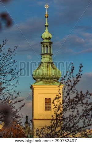 Yellow Bell Tower With Green