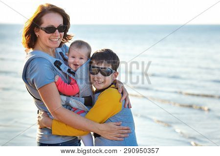 Young Mother With Her Two