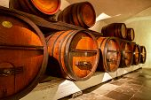 Old Wine Cellar. Pile Of Wine Barrels In A Wine Cellar. Old Wooden Barrels With Wine In A Wine Vault poster