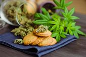 Baking With The Addition Of Cbd. Cookies With Marijuana. Sweets With Cannabis. Cannabis Buds On A Bl poster