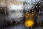 Rainy afternoon city  street through a window - shallow DOF. Detailed transparent texture in macro w poster