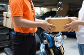 Woman Hand Accepting A Delivery Of Boxes From Deliveryman, Deliver Goods By Motorcycle Service, Fast poster