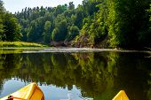 Kayak And Canoe Ride In River Gauja In Latvia. Boat Ride By The River. Beautiful View Of River From  poster