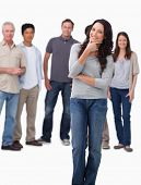 stock photo of thinkers pose  - Woman in thinkers pose with friends behind her against a white background - JPG