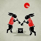 Japanese moon rabbits making mochi (rice cakes) by mortal and pestle