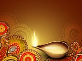 stock photo of ganpati  - Illuminated oil lamp on beautiful floral decorative background for Diwali festival celebration in India - JPG