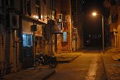 image of tenement  - Empty street and tenement house by night in Chinese city - JPG
