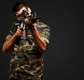 Soldier Gunman Aiming His Target On black Background