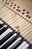 image of tuning fork  - Tuning Fork over piano keys .